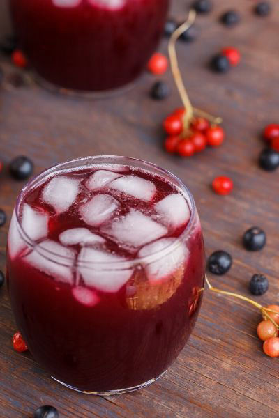 Aronia juice in glass with ice