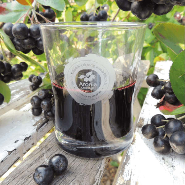 organic aronia berry juice in glass